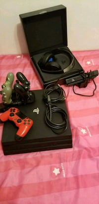 black and red Sony PS3 game controller Surrey, V3R 3C8