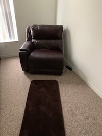 Brown leather electrical recliner with a little Damage from a moving  759 mi