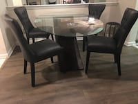 Glass dining table w/ 4 black leather dining chairs Orlando, 32835