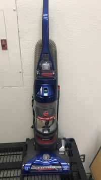 blue and black Bissell upright vacuum cleaner Ventura, 93003
