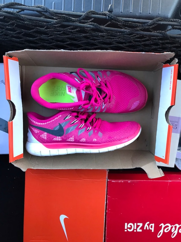 pair of pink Nike basketball shoes