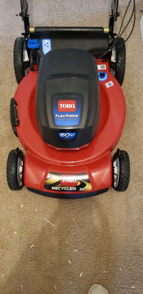Brand new Toro 60v lawn mower with battery and charger. 29426a46-12ea-43cc-b95a-790fe25ee43e