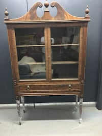 Brown wooden display cabinet