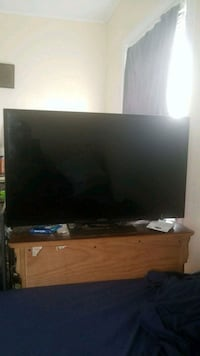 black flat screen TV with brown wooden TV stand Portsmouth, 23707
