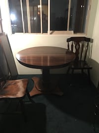 Brown wooden pedestal table 403 mi