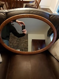 oval shape mirror with brown wooden frame