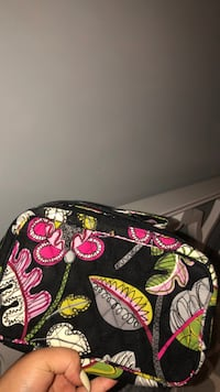 black, red, and white floral backpack Northville, 48168