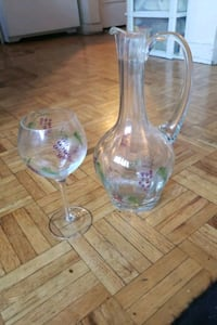 Glass pitcher and wine glass