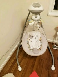 baby's white cradle and swing