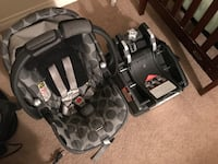 baby's gray and black polka-dot car seat carrier