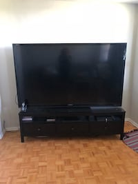 black flat screen TV with black wooden TV stand Toronto, M9C