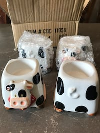 Set of four boiled egg cup holders. Cow farm 722 km