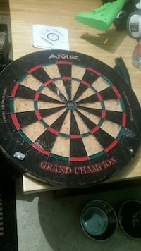 black, green, and red AMF dartboard Edmonton, T5G