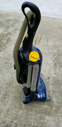 blue and black upright vacuum cleaner