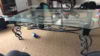 The coffee table glass is quarter inch thick and the base of the table is cast iron  100.00 or best offer Edmonton, T5P 2B2