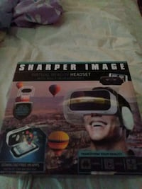 Sharper image virtual reality HEADSET with built headphones