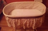 white and gray floral bassinet