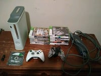 Xbox 360 console with controller and game cases Ashland, 41101