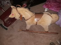 toddler's beige horse ride-on rocking toy