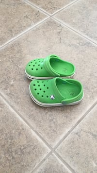 pair of green Crocs clogs Domaine-du-Boisé, J7M 2H1