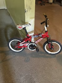 toddler's red and black bicycle Montréal, H4K 2R9