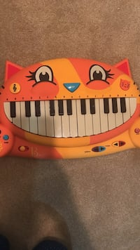 toddler's orange and yellow cat electric keyboard