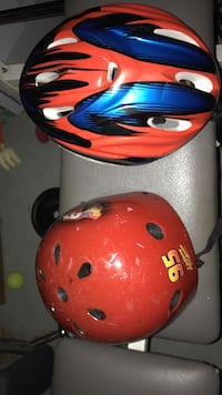 two red and blue-and-red bicycle helmets Lake Worth, 33463