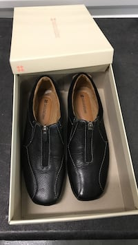 Pair of black leather dress shoes in box