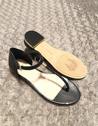 "Vince Camuto T-strap paid $105 Size 8. Sold out everywhere! Style ""Halana"" Black Leather Flat Thong T-strap Womens Sandals Sizing: True to size. Thong toe, Braided T, strap silhouette. Ankle strap with adjustable. Lightly padded footbed. Hardware accented"