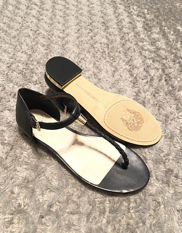 """Vince Camuto T-strap paid $105 Size 8. Sold out everywhere! Style """"Halana"""" Black Leather Flat Thong T-strap Womens Sandals Sizing: True to size. Thong toe, Braided T, strap silhouette. Ankle strap with adjustable. Lightly padded footbed. Hardware accented"""