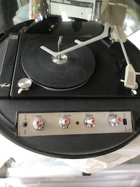 Home - record player - the Apollo round turntable with round speaker.   A true relic of the past.  Still plays good ol' vinyls records. Real novelty!!!  Vancouver, V5V 2H6