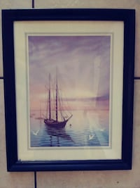 Wood framed boat at sea with sea gulls signed by a Myrtle Beach, 29577