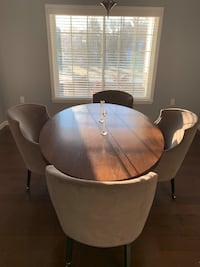 Oval shaped custom made wood dining table and chairs on wheels.  Smithtown, 11787