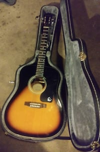 brown and black acoustic guitar Sacramento