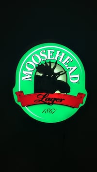 Green and white moosehead lager 1867 signage