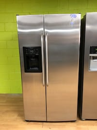 GE stainless steel side by side refrigerator  29 mi