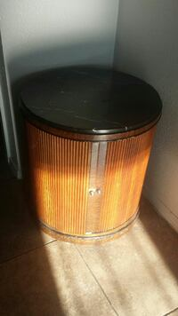 round brown wooden table with storage(minibar)