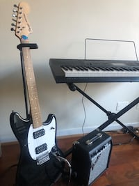 Musical instruments, keyboard and electric guitar with amplifier