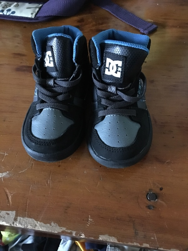 toddler's pair of gray-and-black DC sneakers