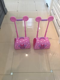 two pink Minnie Mouse luggages 539 km