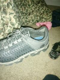 pair of gray-and-white running shoes Cleveland