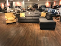 Charcoal gray sectional with matching accent chair