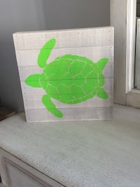 Wooden hanging sign featuring a painted turtle 12x12