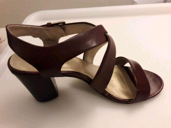 pair of brown leather open-toe ankle strap wedges