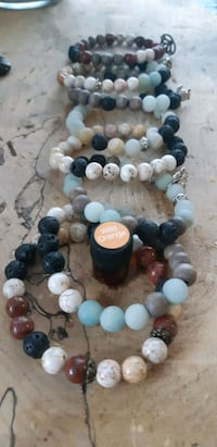 Lava rock and gem stone bracelets with oil sample