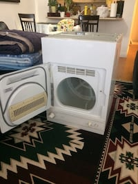 White and gray front-load clothes washer