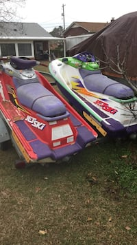 two white and red personal watercrafts