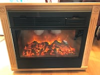 beutiful newer oak fireplace with duel heat and real look flame
