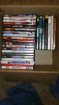 assorted DVD movie cases in box