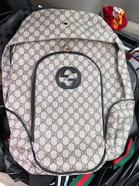 monogrammed brown Gucci leather backpack 28 km